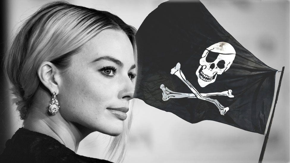 Margot Robbie and a pirate flag