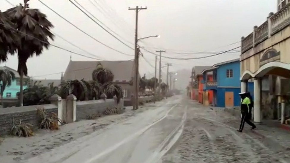 Ash covers road in Georgetown, five miles from the volcano