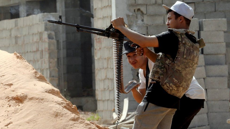 A member of the Libyan internationally recognised government forces fires during a fight with Eastern forces in Ain Zara, Tripoli, Libya April 25, 2019