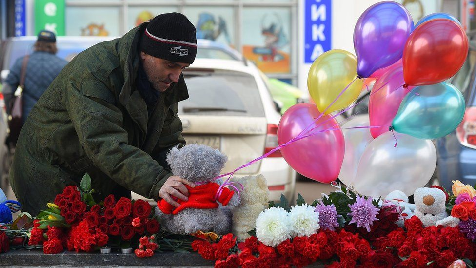A man places a toy at the metro station, where the Uzbek nanny was arrested, on March 1, 2016 at the site