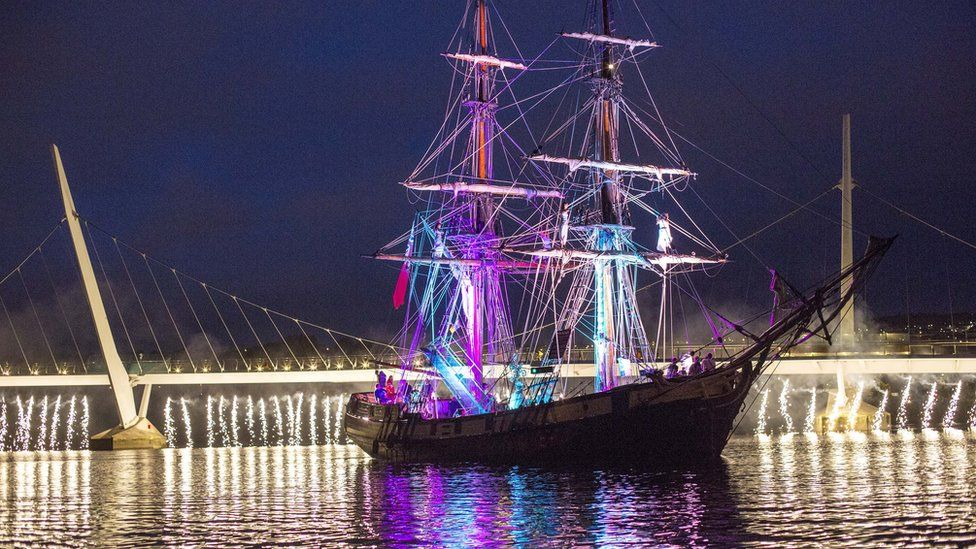 tall ship with peace bridge in background