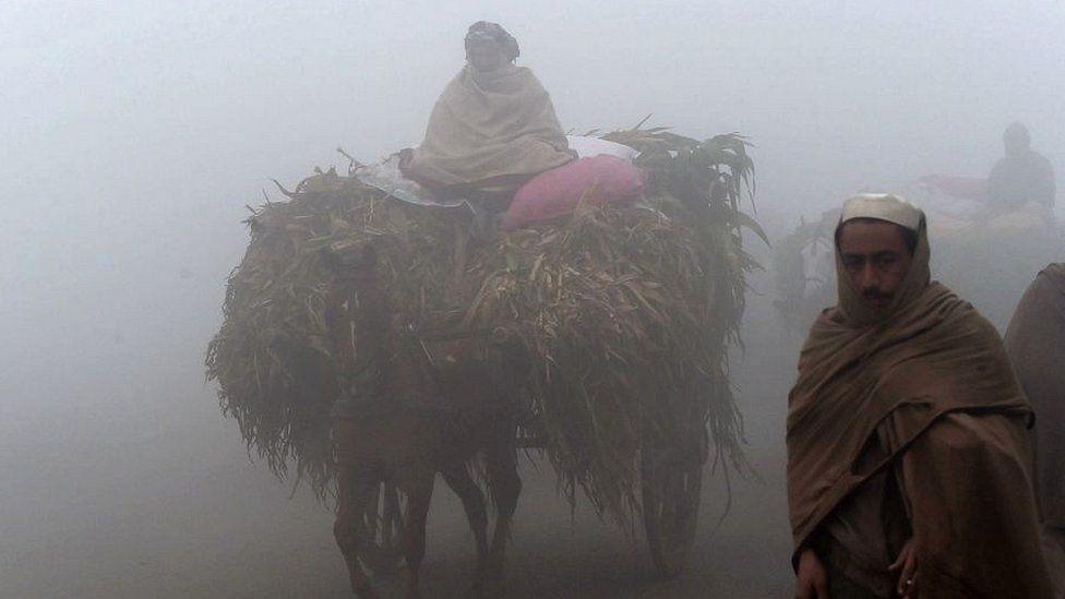 Lahore street scene shrouded in dense smog