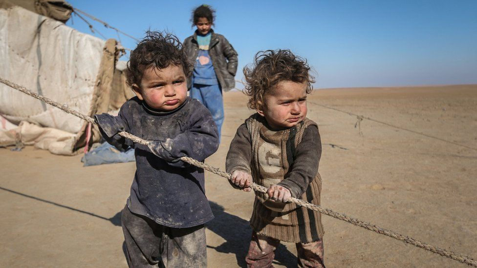 Displaced Syrian children who fled Raqqa city stand near their tent in Ras al-Ain province, Syria January 22, 2017