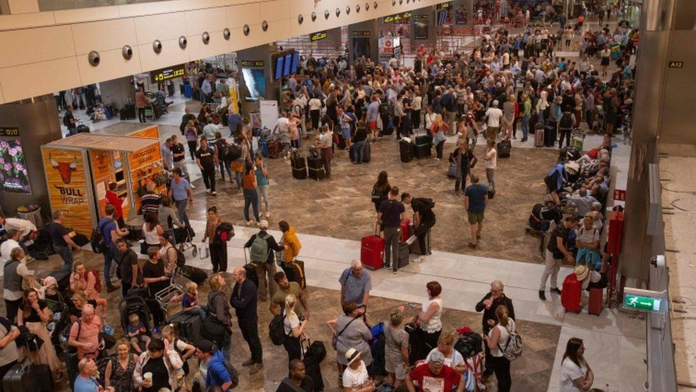 Passengers wait at Tenerife South Reina Sofia Airport after flights were cancelled due to a sandstorm