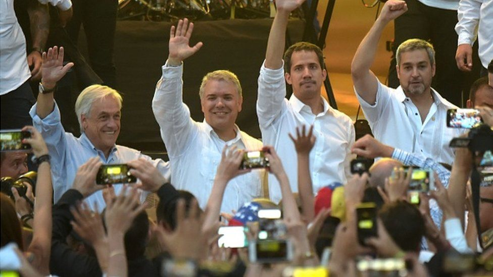 Chilean President Sebastian Pinera, Colombian President Ivan Duque, Venezuela's opposition leader Juan Guaido and Paraguayan President Mario Abdo Benitez wave at the 'Venezuela Aid Live' concert.