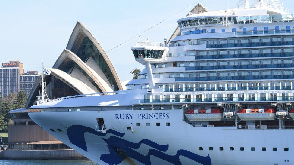An empty Ruby Princess cruise ship heading past Sydney Opera House and out of Sydney Harbour on 19 March.