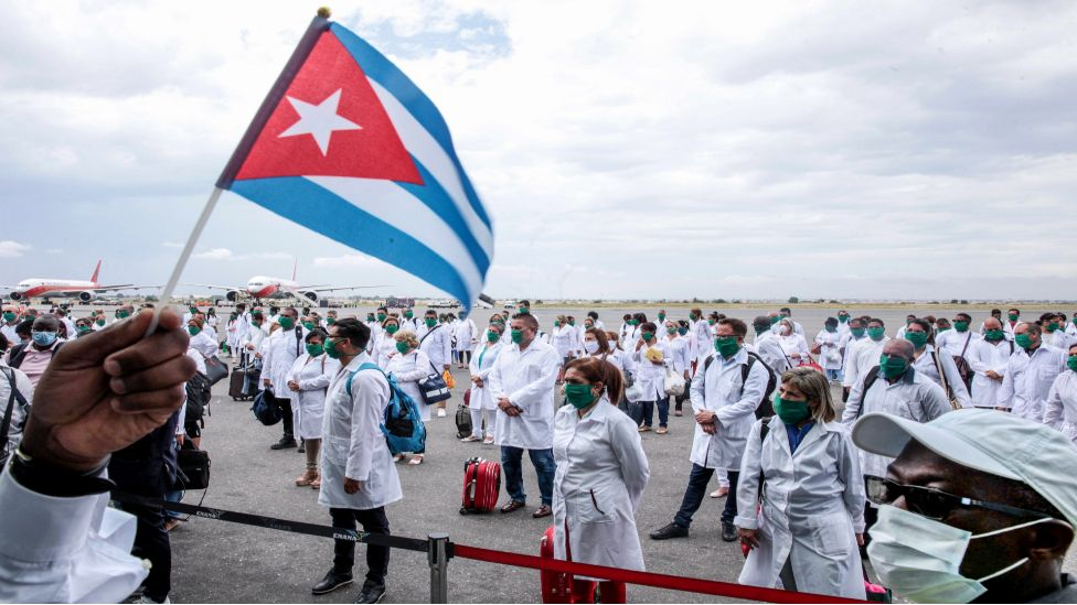 Cuban doctors at the airport after arriving Angola on Friday