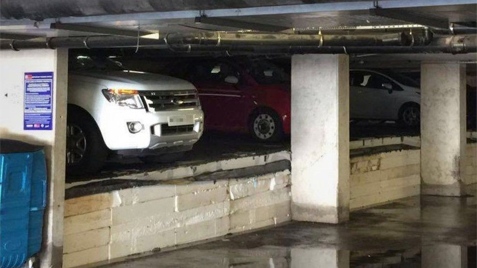 Damaged cars in underground car park