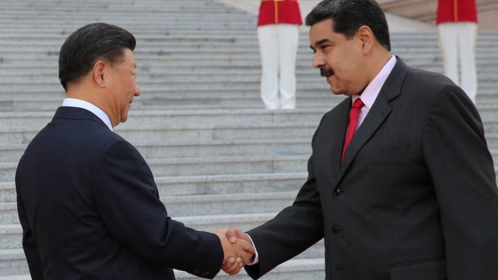 Chinese President Xi Jinping and Venezuela's President Nicolás Maduro shake hands during his welcoming ceremony in Beijing, 14 September 2018.