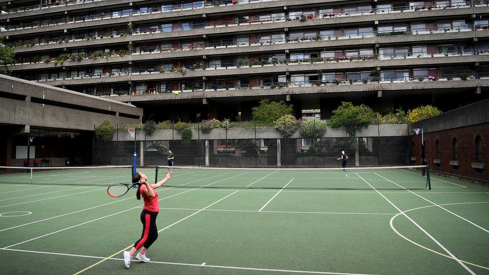 Residents in Barbican, London, playing tennis