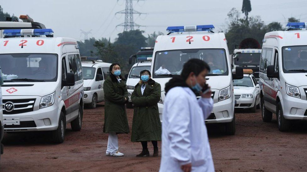 Rescue personnel wait beside parked ambulances outside the Diaoshuidong coal mine in south-western China's Chongqing on December 5, 2020,