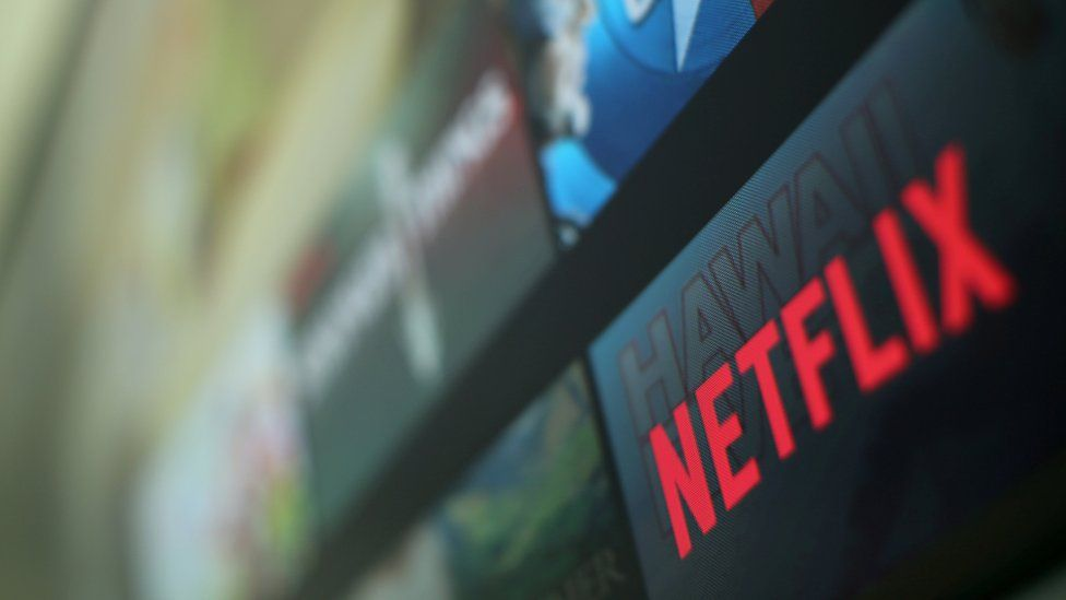The Netflix logo is pictured on a television screen