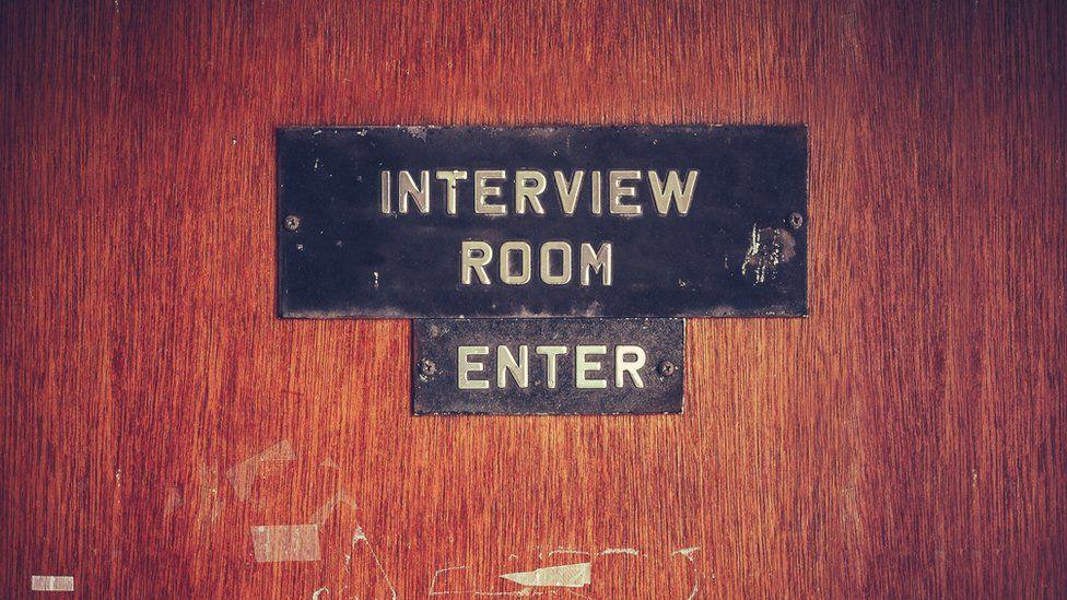 Tatty interview room door