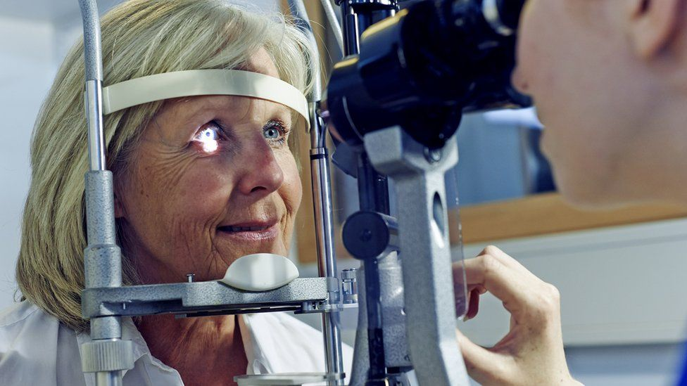 older woman having eye test