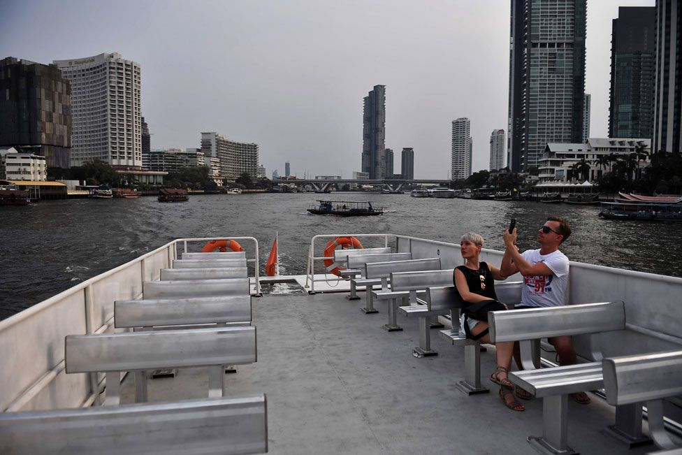 A lone couple take a tourist boat on the Chao Phraya River in Bangkok. 16 March