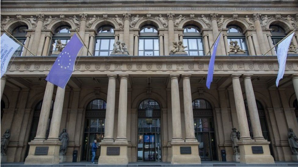 European flags hang above the entrance of the stock exchange in Frankfurt am Main, Germany