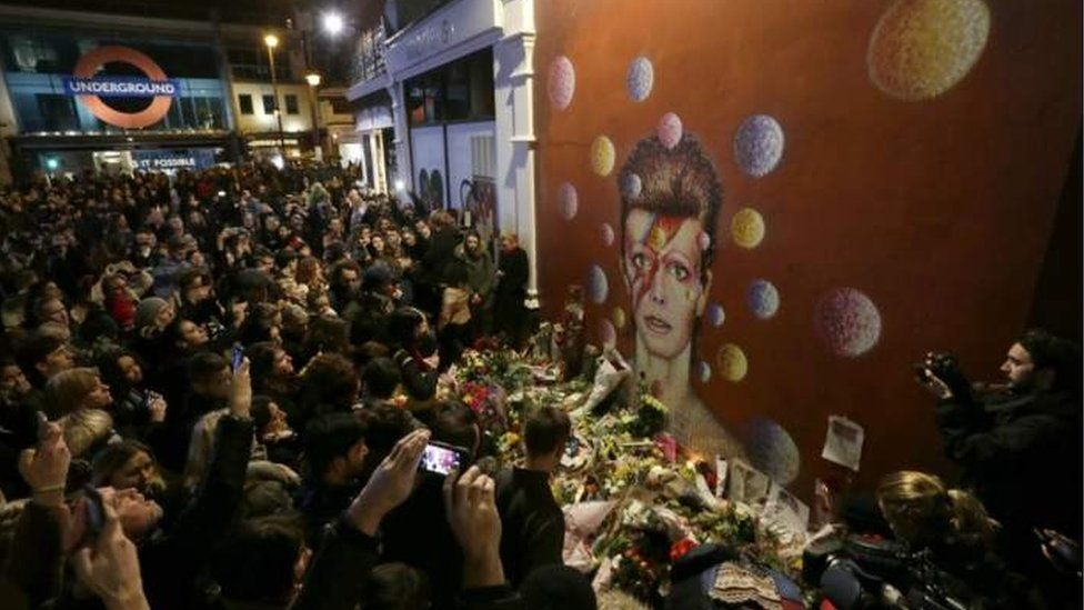 Crowds of fans gathered at the David Bowie mural in Briston south London