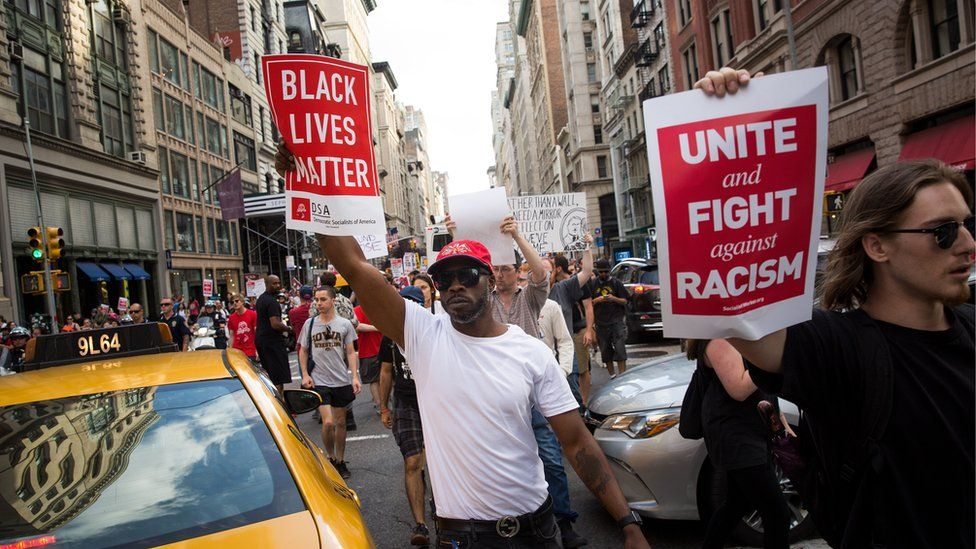 Protestors make their way north on Fifth Avenue as they march against white supremacy and racism, August 13, 2017 in New York City.