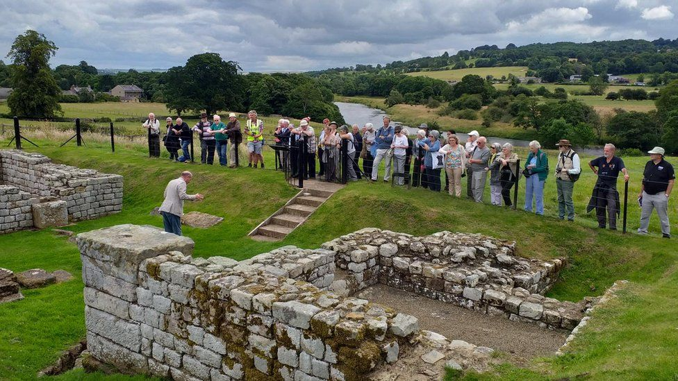 Dr Nick Hodgson explaining the East Gate at Chesters