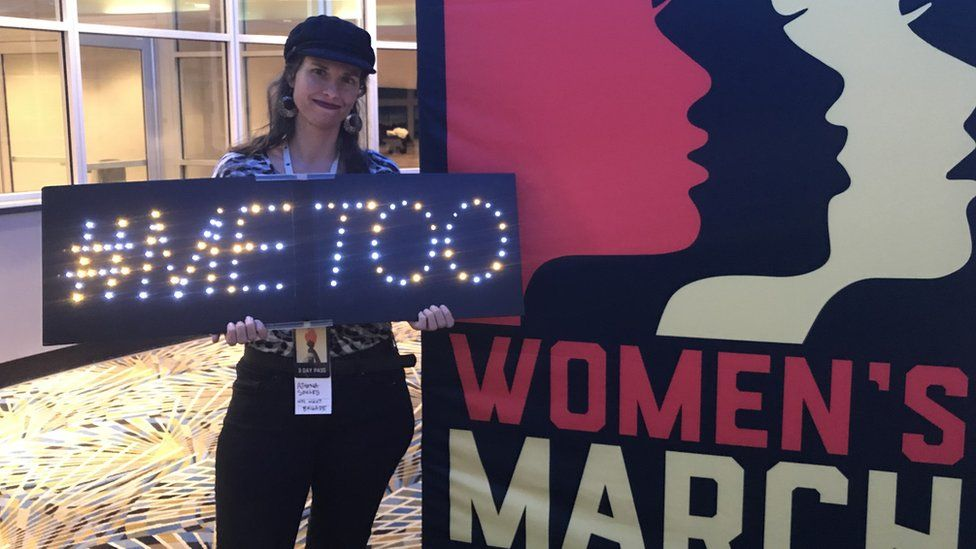 """Athena Soules holds up her """"#metoo"""" sign"""
