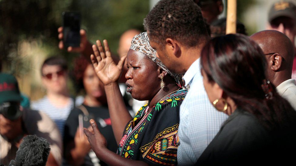 Agnes Hasam, a family friend of the Alfred Olango, speaks to protesters gathered at the El Cajon Police Department headquarters to protest fatal shooting of an unarmed black man Tuesday by officers in El Cajon, California, U.S. September 28, 2016.