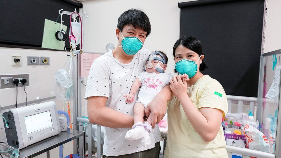Kwek Yu Xuan with her parents before his discharge from hospital