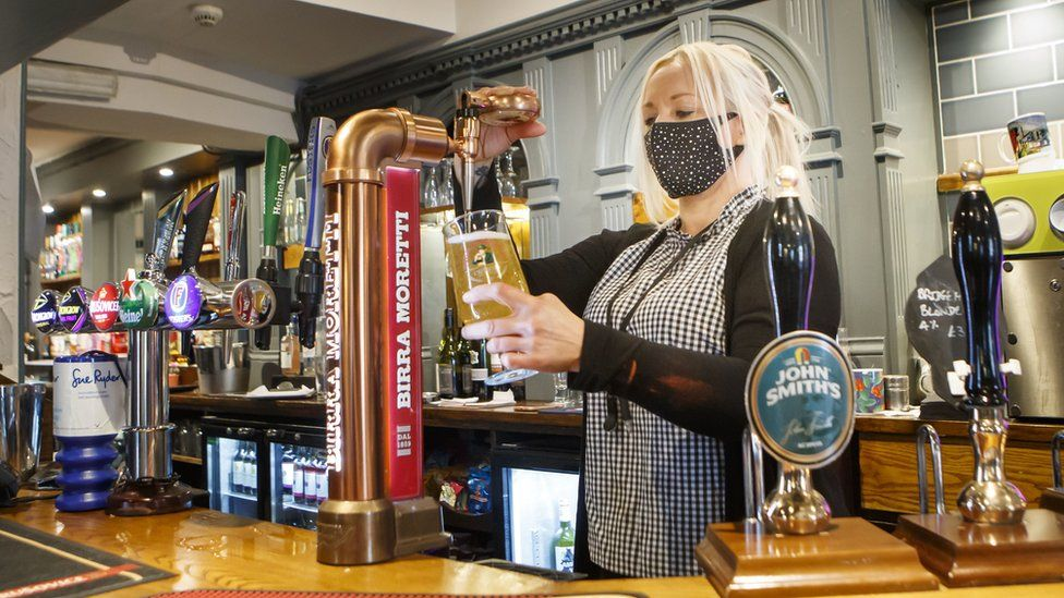 Melanie Scott pulls a pint at the Black Bull pub in Haworth, West Yorkshire