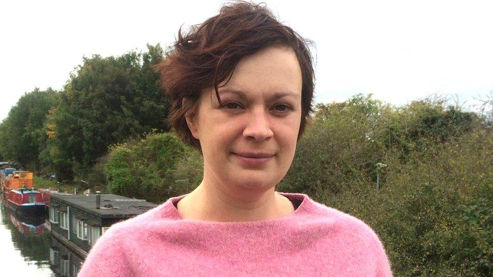 Emma Robertson standing next canal