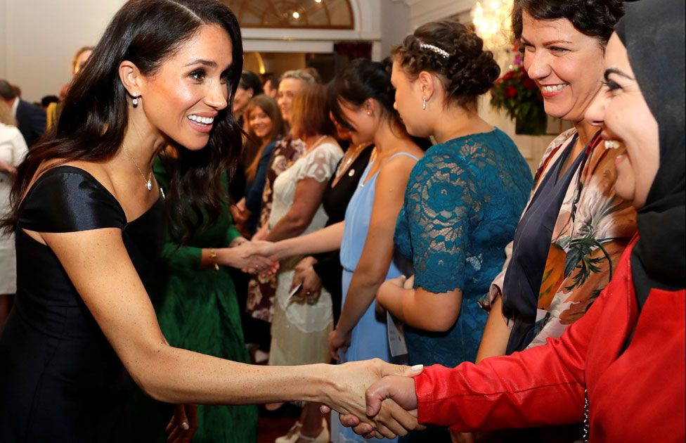 Meghan greeting guests at a reception to celebrate the anniversary of women's suffrage