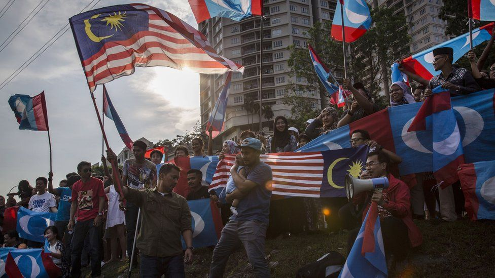 Supporters of Mahathir Mohamad, wait for him to be sworn in as Malaysian prime minister May 10, 2018