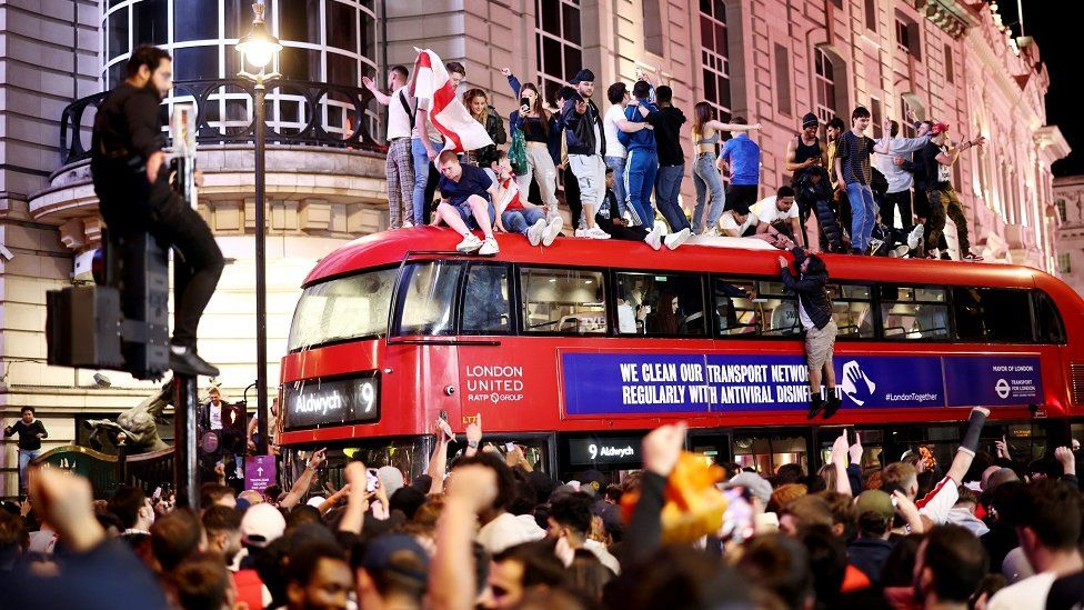 Fans gather for England v Denmark - Piccadilly Circus
