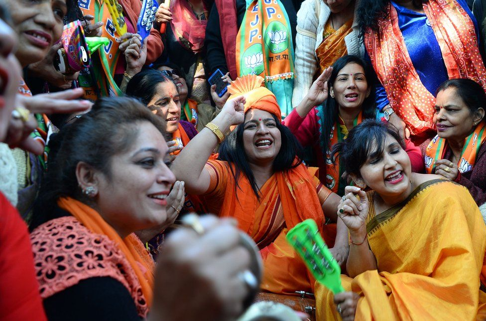 Supporters of the Bharatiya Janata Party celebrate outside the party headquarters in Delhi