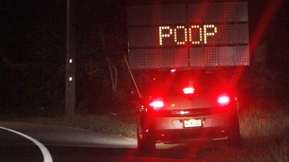 POOP street sign