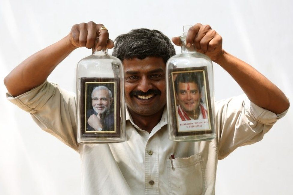 Indian bottle artist Basavaraj displays bottles designed with photos of Indian Prime Minister Narendra Modi and President of the Indian National Congress Rahul Gandhi during general elections in Bangalore, India, 12 April 2019