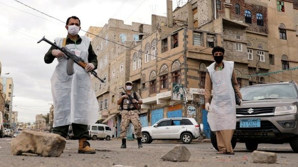 Masked security officers patrol the streets of Sanaa, Yemen. Photo: May 2020