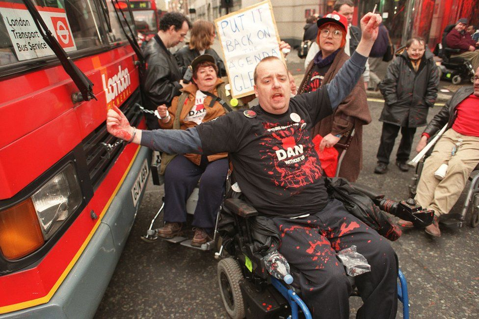 DAN protestors in front of a bus