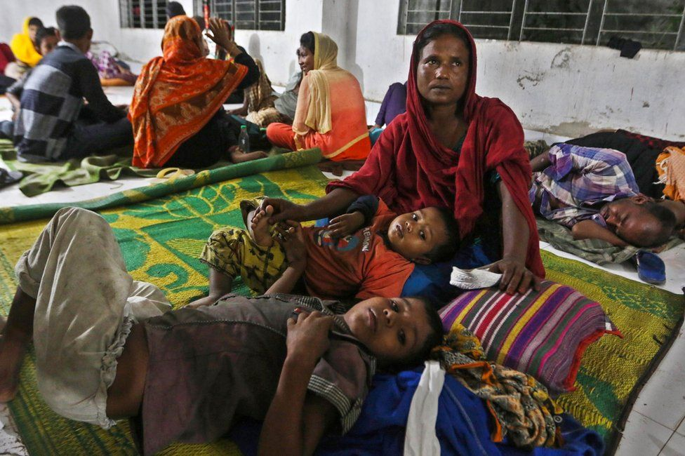 Bangladeshi villagers take refuge in a cyclone shelter following an evacuation by authorities in the coastal villages of the Cox's Bazar district on 29 May 2017.