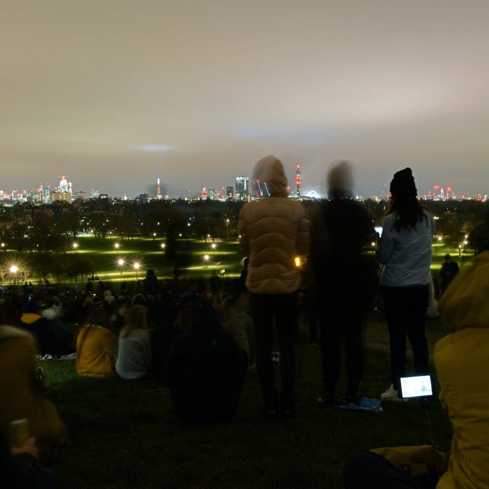 People gathered to look at the London skyline