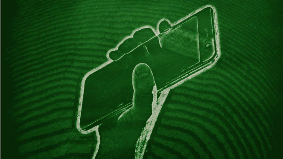 GETTY IMAGE of hand holding smartphone