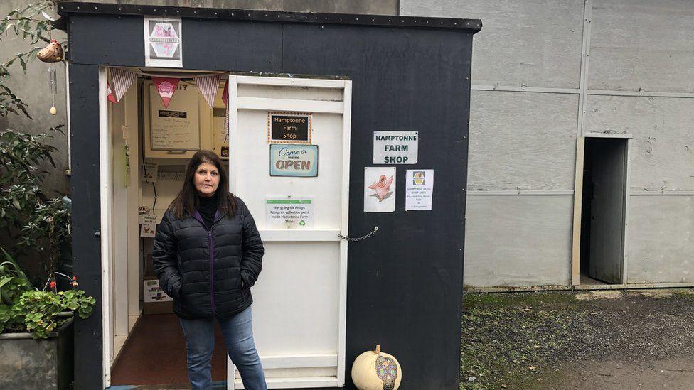 Sue Emmanuel outside honesty shop