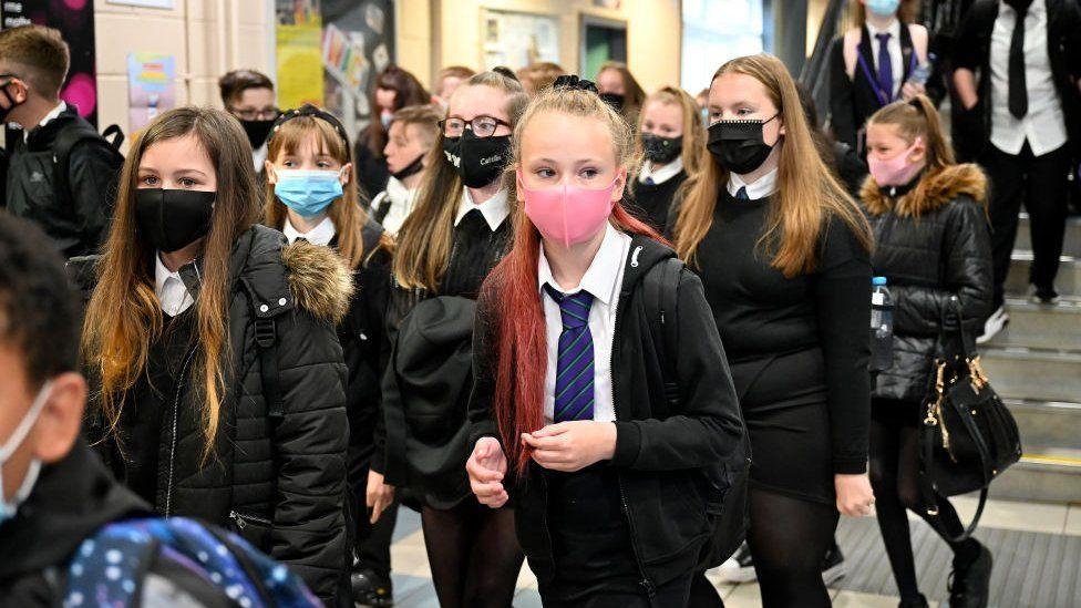 School corridor with secondary school pupils wearing masks