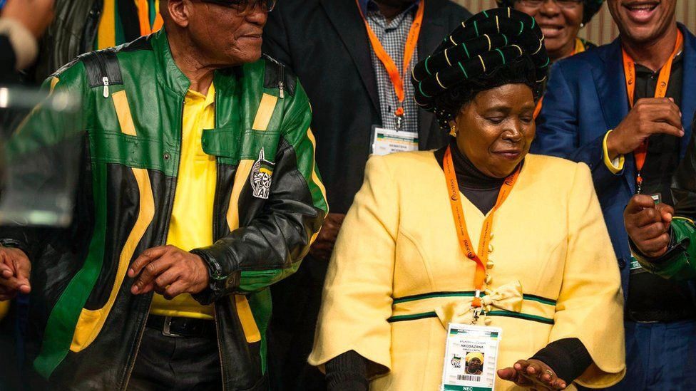 Nkosazana Dlamini-Zuma (C) flanked by Jacob Zuma dances after the closing session of the ANC policy conference 05/07/2017