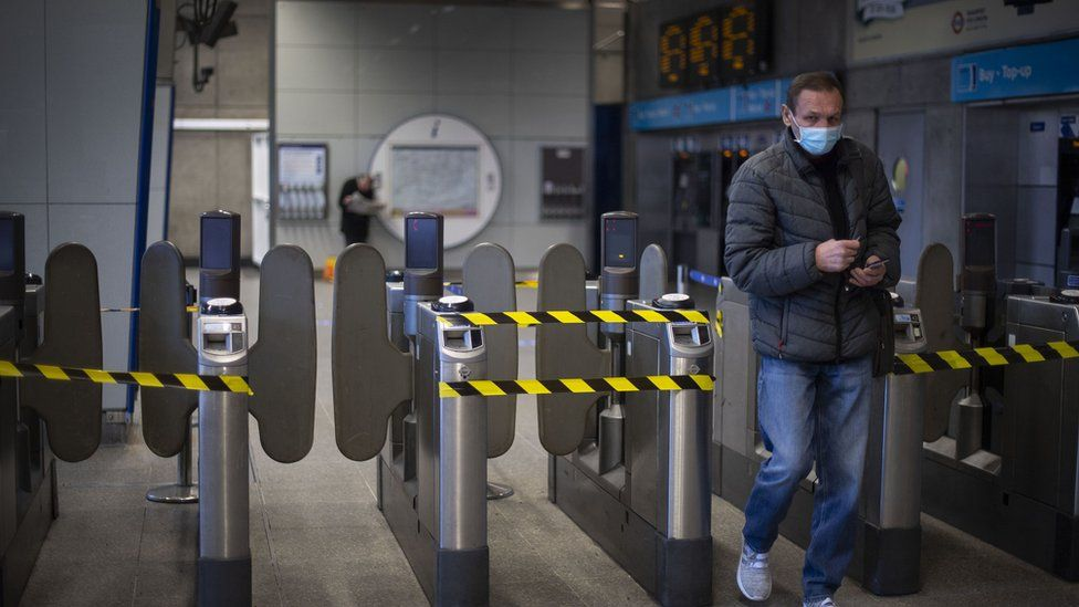 Alternate ticket barriers are taped off at Waterloo tube station on the London Underground