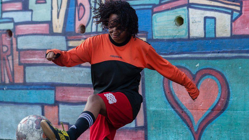 Mayara practises weaving her foot around the ball on the training field