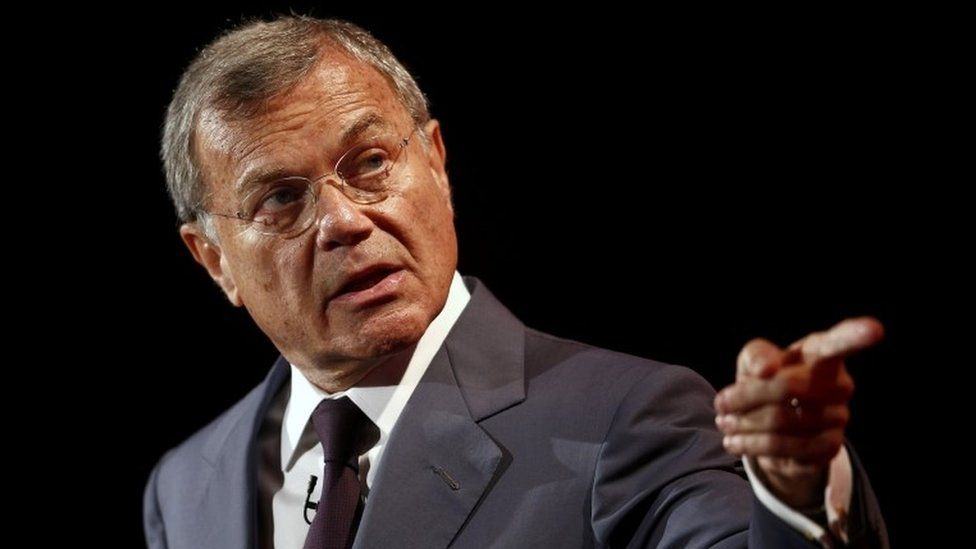 Martin Sorrell pointing on a stage