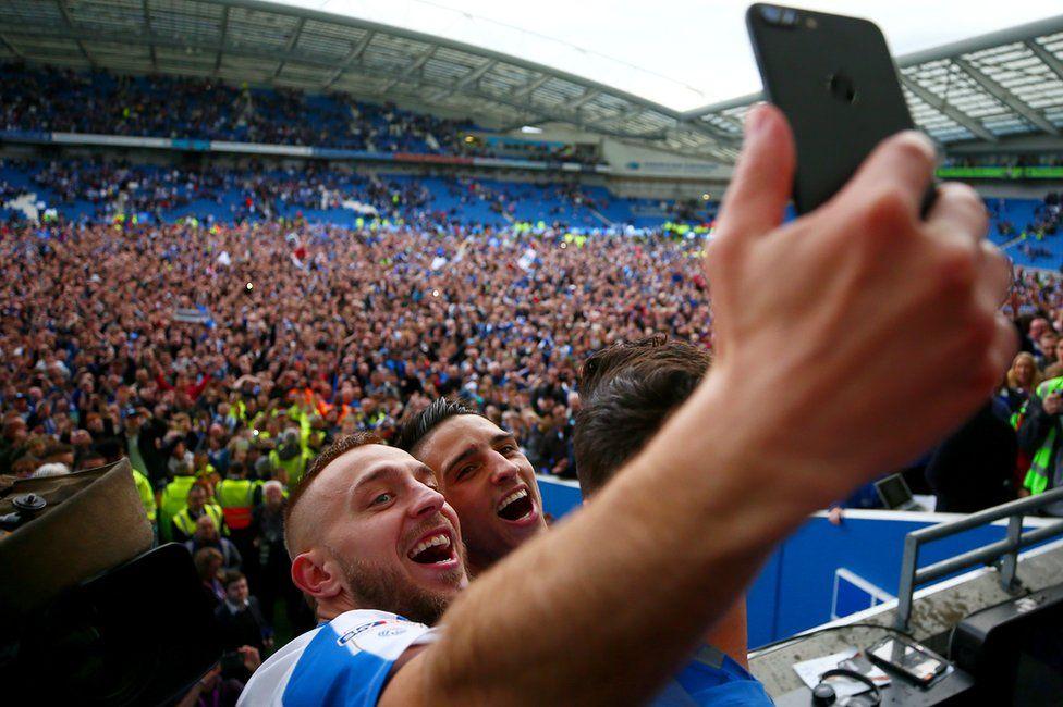 Anthony Knockaert and Jiri Skalak of Brighton & Hove Albion celebrate with team-mates