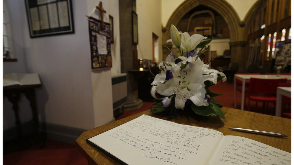 """Messages of condolence written by Prime Minister David Cameron and Labour Party leader Jeremy Corbyn in a book of remembrance for Jo Cox in St Peter""""s church in Birstall, West Yorkshire"""