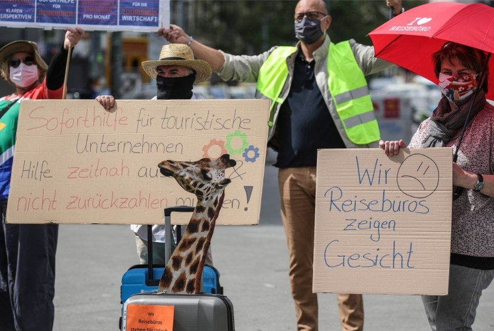 Employees of travel agencies, tour operators and bus companies, wearing face masks and keeping social distancing, demonstrate to demand support and rescue funding in Frankfurt am Main, Germany, 29 April 2020