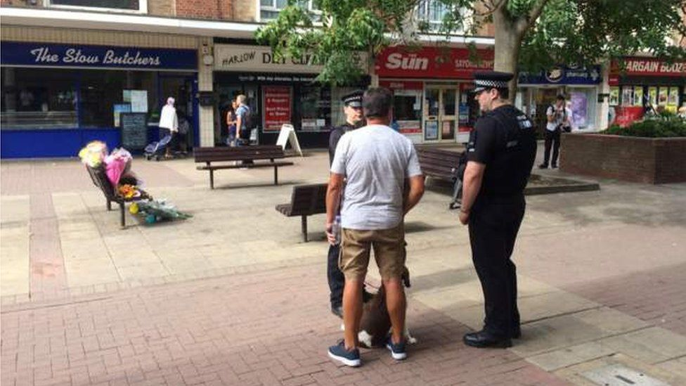 Police speaking to locals in The Stow