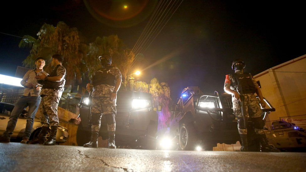 """Security forces stand guard outside the Israeli embassy in the residential Rabiyeh neighbourhood of the Jordanian capital Amman following an """"incident"""" on July 23, 2017"""